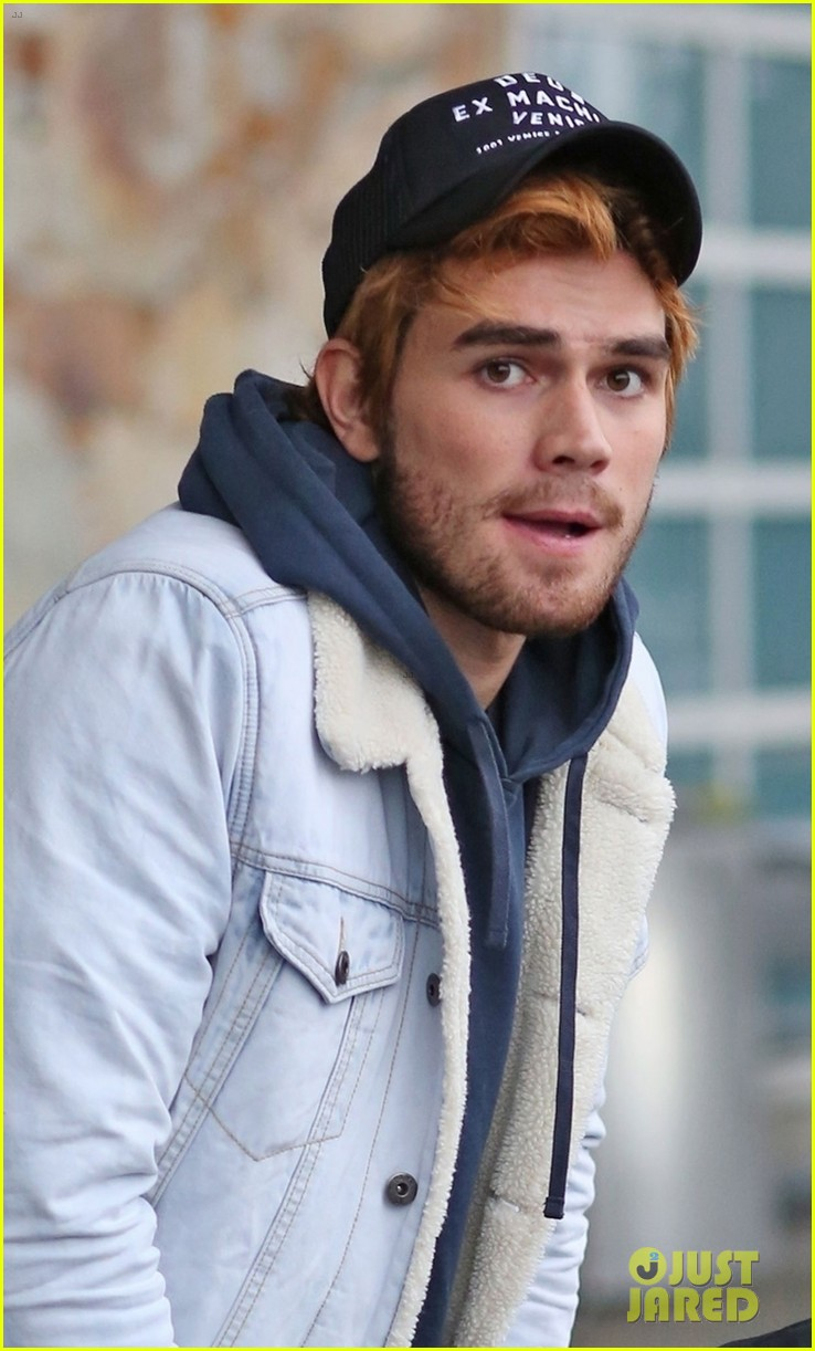 kj apa arrives in vancouver with mystery blonde 06